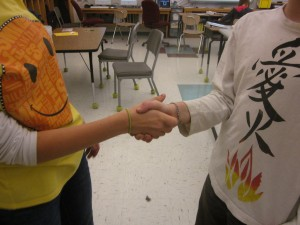 Shaking hands during Dinner Party.  Could it be the murderer?